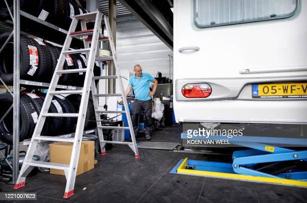 An employee check a caravan at a dealer ship in Almere on June18 as sales of caravans and motorhomes has increased due to the novel coronavirus,...