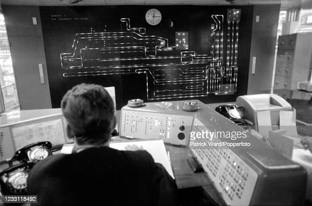 An employee checking the production line flow at British Leyland factory at Longbridge, the West Midlands, circa June 1969. From a series of images...