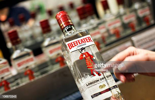An employee checks a bottle of Beefeater gin at the Pernod Ricard SA bottling plant in Dumbarton UK on Friday Nov 19 2010 Pernod Ricard SA the...
