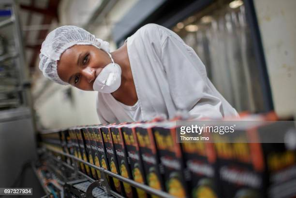 An employee checks a conveyor belt on which Tetra Paks with fruit juice are transported Production of juice at beverage manufacturer Kevian Kenya Ltd...