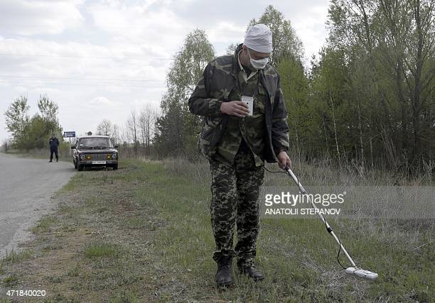An employee checks a radiation levels in Chernobyl zone near the place of recent forest fire on May 1 2015 Firefighters have nearly extinguished a...