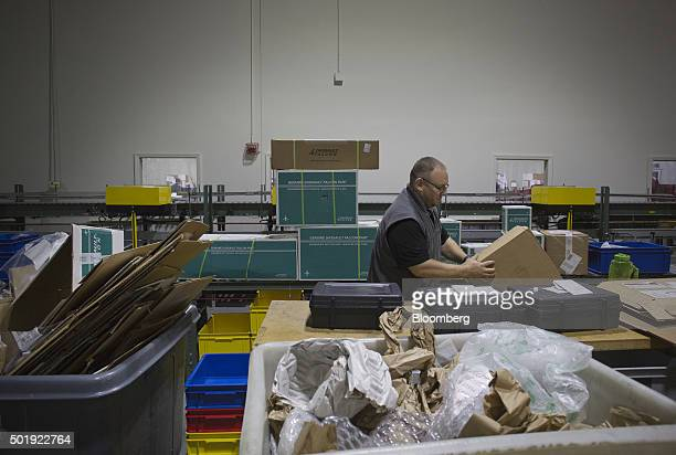 An employee checks in tools for jets at the Dassault Aviation SA Falcon Jet parts distribution center at Teterboro Airport in Teterboro New Jersey US...