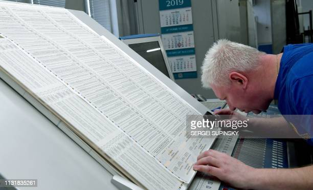 An employee checks printed ballots papers at the Ukraine printing plant in Kiev on March 21 2019 Ukraine is to hold presidential elections on March...