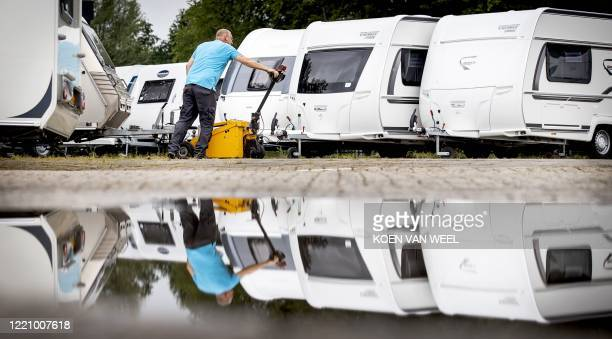 An employee checks the caravans at a dealer ship in Almere on June18 as sales of caravans and motorhomes has increased due to the novel coronavirus...