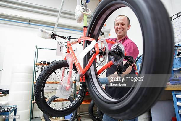 An employee checks the gear indexing on a custom madetoorder fat bike inside the KTM Fahrrad GmbH bicycle manufacturing facility in Mattighofen...