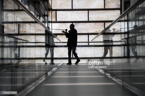 An employee cleans a corridor at The Beaux Arts Museum in Nantes, western France on February 12, 2020.