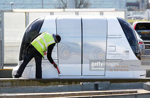 An employee cleans a self driving pod at a car park at Heathrow airport in London UK on Tuesday March 29 2016 Some of the Ultra Global PRT Pods will...