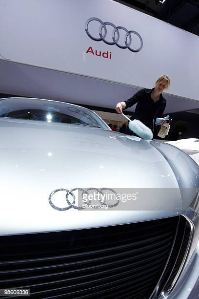An employee cleans an Audi AG automobile at the Volkswagen AG annual shareholders' meeting in Hamburg Germany on Thursday April 22 2010 Volkswagen AG...