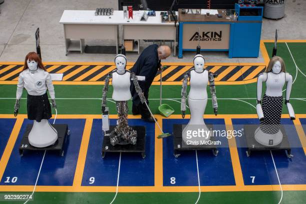 An employee cleans around early test robot displays at the Akin Robotics factory on March 15 2018 in Konya Turkey Akin Robotics is Turkey's first...