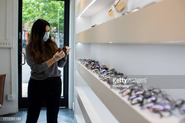 An employee cleans glasses inside a store in the NoDa neighborhood of Charlotte North Carolina US on Friday May 8 2020 Governor Roy Cooper is lifting...
