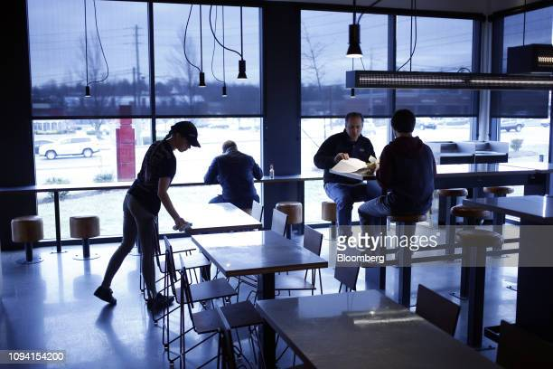 An employee cleans tables as customers eat at a Chipotle Mexican Grill Inc restaurant in Louisville Kentucky US on Saturday Feb 2 2019 Chipotle...