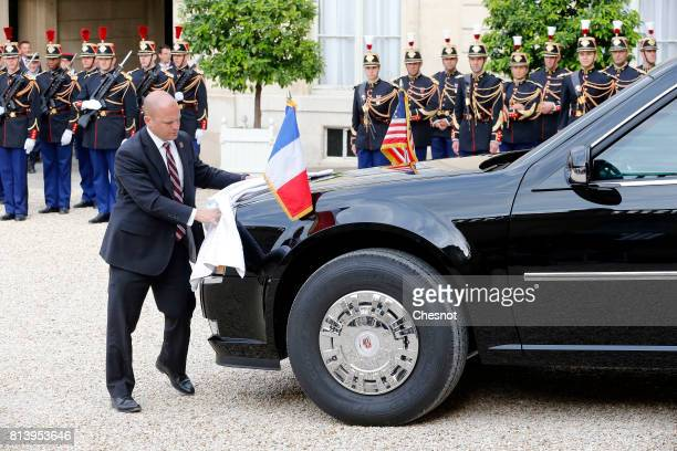 An employee cleans the car of US President Donald Trump at the Elysee Presidential Palace on July 13 2017 in Paris France As part of the...