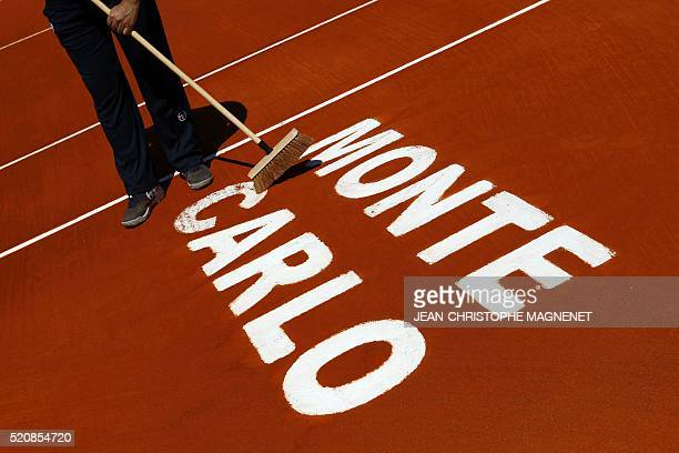 An employee cleans the court prior to a MonteCarlo ATP Masters Series Tournament tennis match on April 13 2016 in Monaco AFP PHOTO / JEAN CHRISTOPHE...