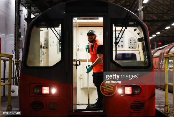 An employee cleans the drivers cab of a train used on the Northern Line of the London Underground network, at the Morden Traincare Centre, operated...