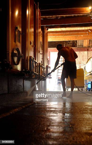 An employee cleans the floor prior to the grape harvest at Chateau Bousquette in Cessenon, France, on Thursday, Aug. 20, 2009. Heightened consumer...