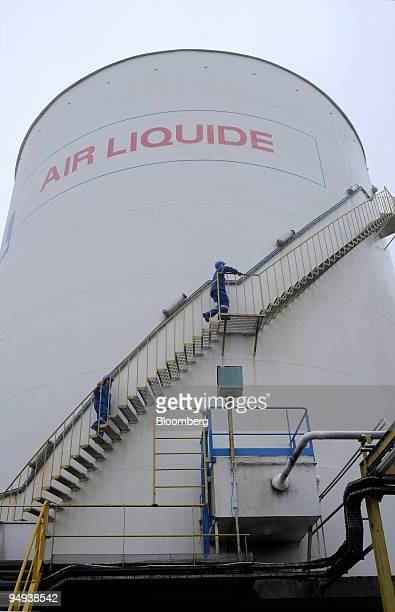 An employee climbs a storage tank at the Air Liquide factory in Moissy Cramayel France on Friday Feb 13 2009 Air Liquide SA the world's biggest maker...