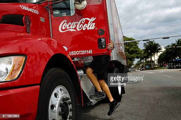 An employee climbs into the driver seat of a CocaCola Co delivery truck in Miami Beach Florida US on Monday Oct 24 2016 The CocaCola Co is scheduled...