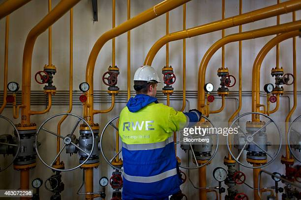 An employee closes a pipe control wheel at the underground gas storage facility operated by RWE AG in Dolni Dunajovice Czech Republic on Monday Feb 9...