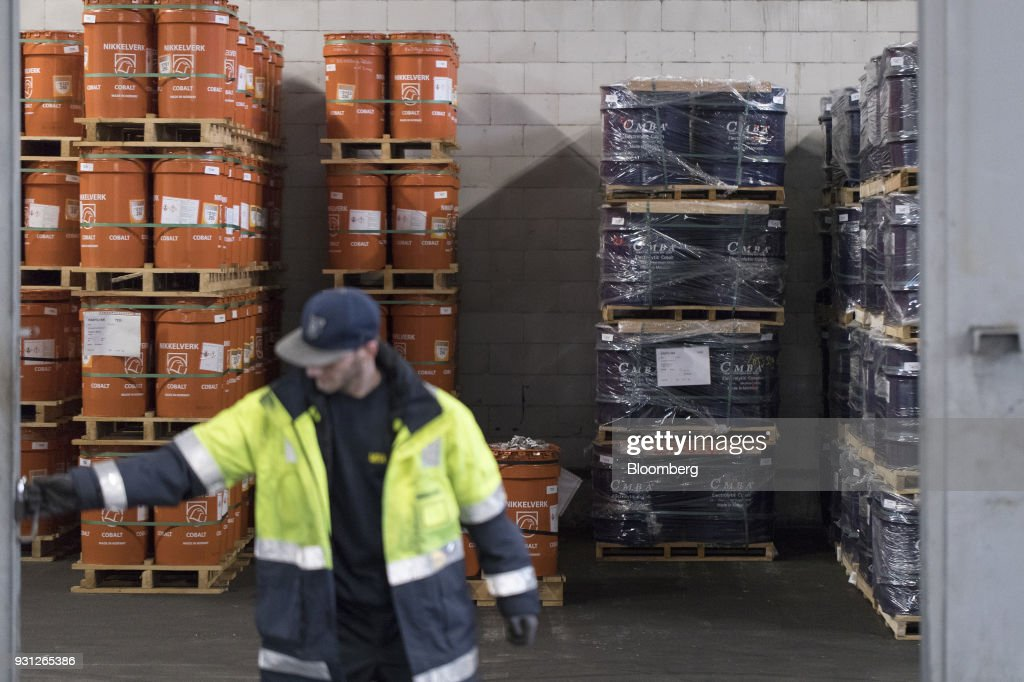 An employee closes the door as barrels of cobalt, owned by Cobalt 27 Capital Corp., stand beyond in Rotterdam, Netherlands, on Monday, Jan. 22, 2018. Cobalt 27 holds almost 3,000 metric tons of cobalt, the largest private stockpile on the planet. Photographer: Jasper Juinen/Bloomberg via Getty Images