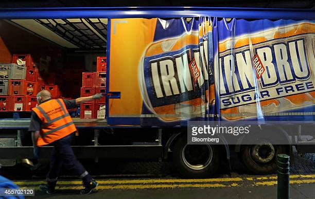 An employee closes the side of an AG Barr Plc IrnBru branded drinks delivery truck in Glasgow UK on Friday Sept 19 2014 Scotland voted to remain in...