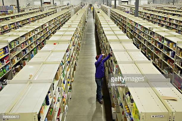 An employee collects items for customer orders at the Jetcom Inc fulfillment center on Cyber Monday in Kansas City Kansas US on Monday Nov 30 2015...
