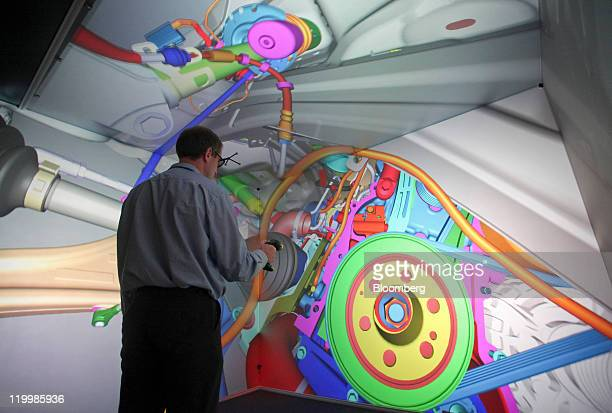 An employee controls a three dimensional model of the engine bay of a Range Rover Evoque by Jaguar Land Rover Plc on a Virtual Reality Design Screen...
