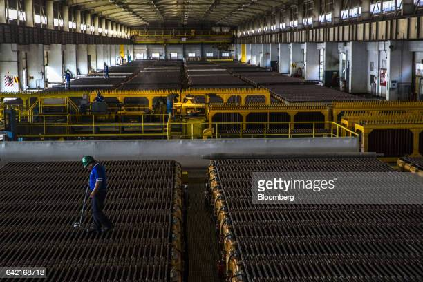 An employee controls the voltage of a large acidfilled tank during the electrolytic refining process of copper anodes at the Southern Copper Corp...