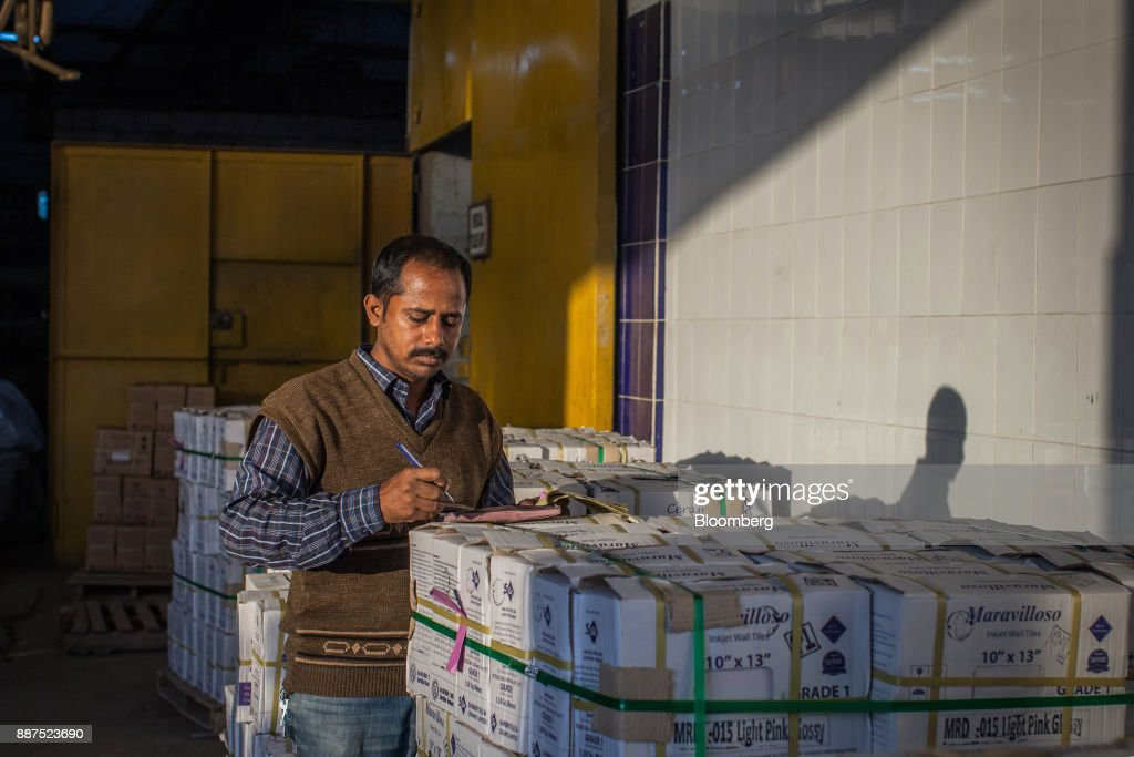 An employee counts boxes of tiles before delivery to the warehouse at the Shabbir Tiles & Ceramics Ltd. production facility in Karachi, Pakistan, on Wednesday, Dec. 6, 2017. Shabbir, which had suffered four years of losses while fighting to compete with cheap imports from neighboring China, is on course to post an annual profit next financial year after Pakistan placed an anti-dumping duty on Chinese tiles in October. That follows similar moves from the regulator on steel products. Photographer: Asim Hafeez/Bloomberg via Getty Images