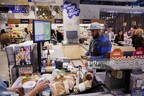 An employee counts cash at a register while ringing up a customer at the new Whole Foods Market Inc store in downtown Los Angeles California US on...
