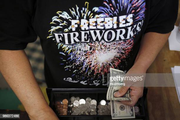 An employee counts money at a cash register inside a fireworks store in Catlettsburg Kentucky US on Thursday June 28 2018 According to the American...