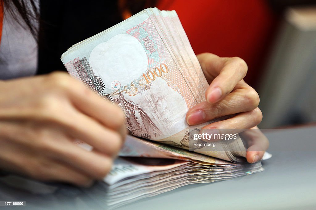 Thai Baht At A Currency Exchange Bureau As Falls To Three Year Low