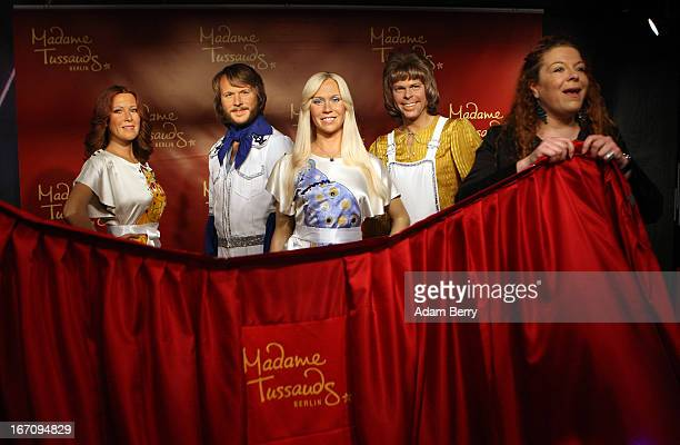 An employee covers up wax figures of the members of the Swedish pop group ABBA AnniFrid Lyngstad Benny Andersson Agnetha Faltskog and Bjoern Ulvaeus...