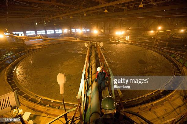 An employee crosses a platform inside the chemical enrichment area of the potash plant operated by OAO Uralkali in Berezniki Russia on Monday Aug 26...