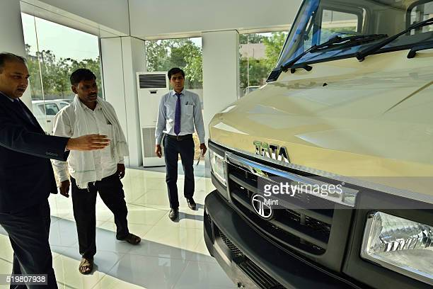 An employee dealing with a costumer at Tata truck showroom on June 3, 2015 in Faridabad, India.