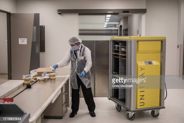 An employee delivers boxed lunches to the medical staff working inside the COVID19 dedicated ICU at the Acibadem Altunizade Hospital on April 16 2020...