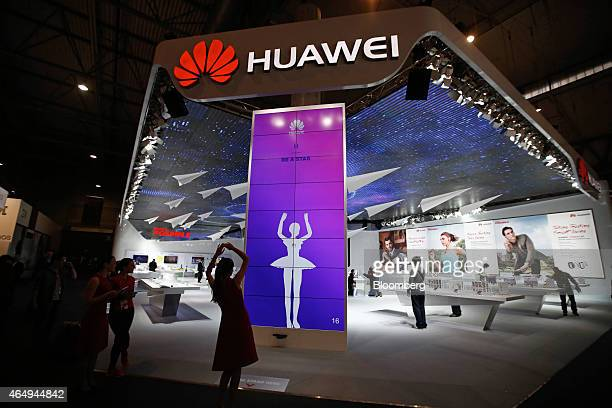 An employee demonstrates a digital ballerina application to map movements on a screen at the Huawei Technologies Co pavilion at the Mobile World...