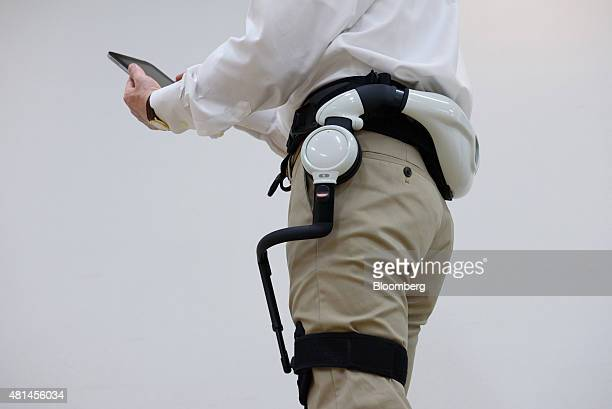 An employee demonstrates a Honda Motor Co assistive walking device during a media preview in Tokyo Japan on Tuesday July 21 2015 Honda starts to...