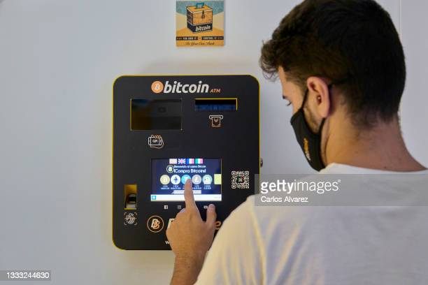 An employee demonstrates how the Bitcoin ATM works at the BitBase Store on August 09, 2021 in Palma de Mallorca, Spain.