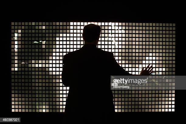 An employee demonstrates motion sensors on a organic lightemitting diode installation at Royal Philips NV's Lumiblade Creative Lab in Aachen Germany...