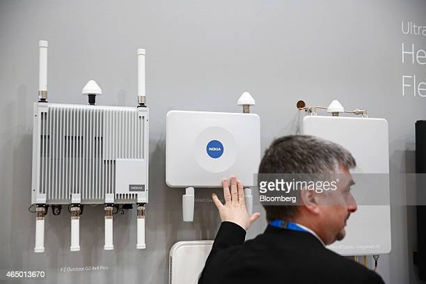 An employee demonstrates outdoor digital network devices manufactured by Nokia Solutions and Networks in the Nokia Oyj pavilion at the Mobile World...