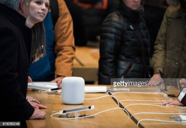 An employee demonstrates the HomePod speaker on the first day of sales at an Apple Inc store in New York US on Friday Feb 9 2018 Apple Inc's...