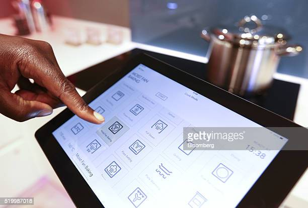 An employee demonstrates the use of an AEG Procombi Plus Smart oven controlled from a tablet device inside the Smart Home section at a John Lewis Plc...