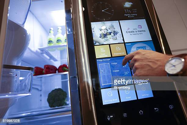 An employee demonstrates the use of the fridge manager on a Samsung Electronics Co Family Hub fridge freezer inside the Smart Home section at a John...