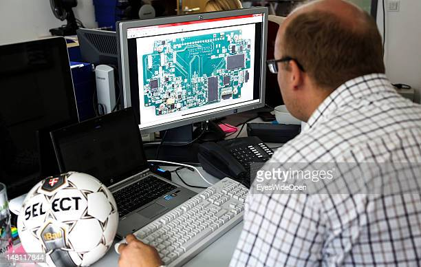 An employee demontrates the GoalRef Technology system on a computer with a magnetic field at Fraunhofer IIS research institute on July 10 2012 in...