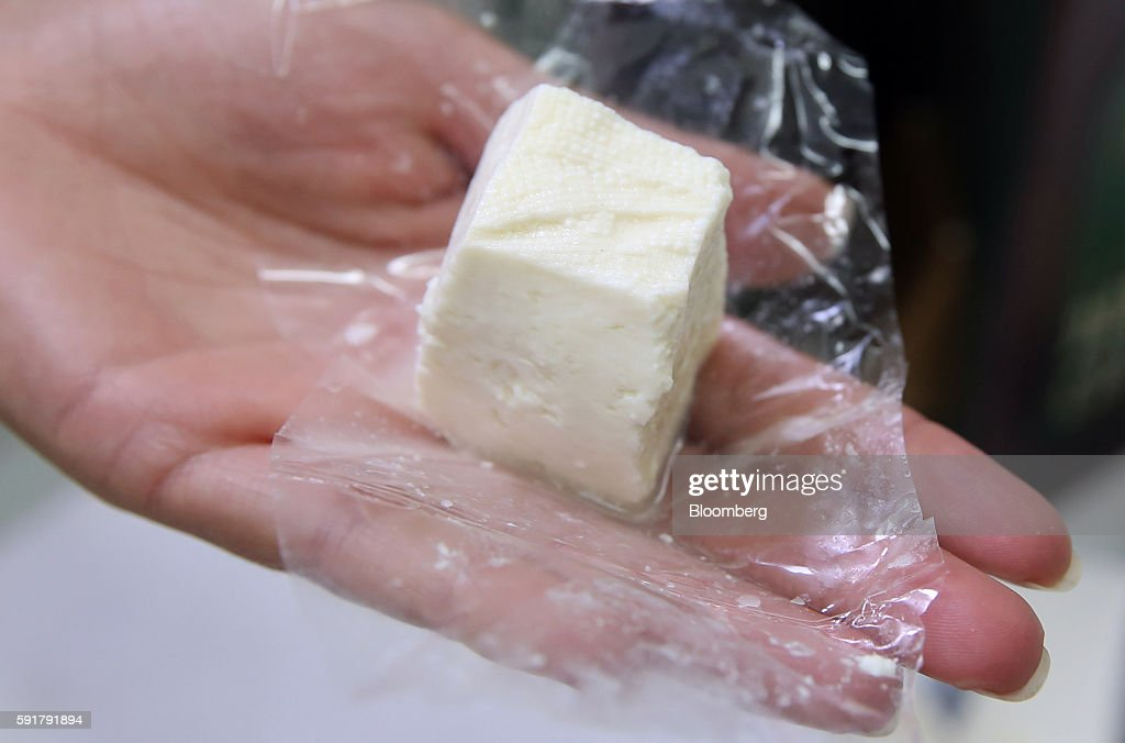 An employee displays a 50 gram block of Serbian donkey cheese, locally known as pule, which retails for 50-70 euros at the Special Nature Reserve of Zasavica in Zasavica, Serbia, on Wednesday, Aug. 17, 2016. Pule cheese is made from the milk of Balkan donkeys and is priced at 1100 euros per kilo and reported to be the world's most expensive cheese. Photograph: Oliver Bunic/Bloomberg via Getty Images