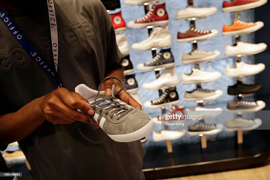 An Employee Displays A Adidas AG Shoe Inside An Office Fashion Footwear  Store, Operated By