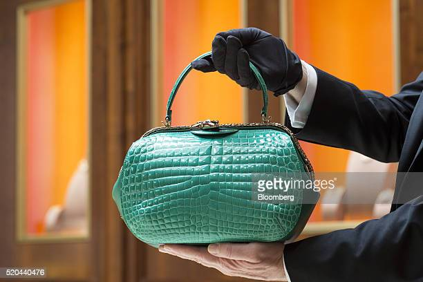An employee displays a Bulgari Serpenti Hypnotic crocodile leather handbag inside a Bulgari SpA boutique, a luxury unit of LVMH Moet Hennessy Louis...