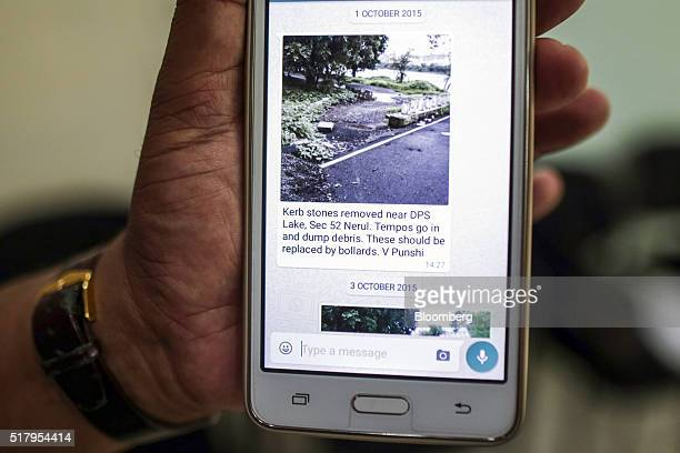 An employee displays a Whatsapp communication of an alleged case of illegal debris dumping in the Belapur area of Navi Mumbai at the Navi Mumbai...
