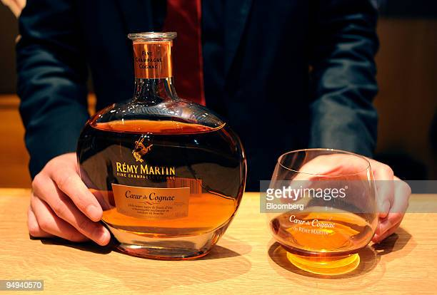An employee displays Remy Martin cognac at the company's distillery in Cognac France on Tuesday April 14 2009 Remy Cointreau SA France's second...