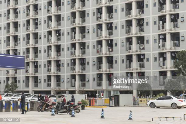 An employee dormitory building stands at the Contemporary Amperex Technology Ltd headquarters and manufacturing complex in Ningde Fujian Province...